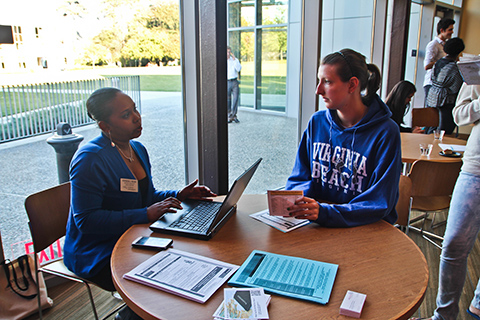 Stephenie Wilson, Interim Director of Career Education, introduces a student to some of the office