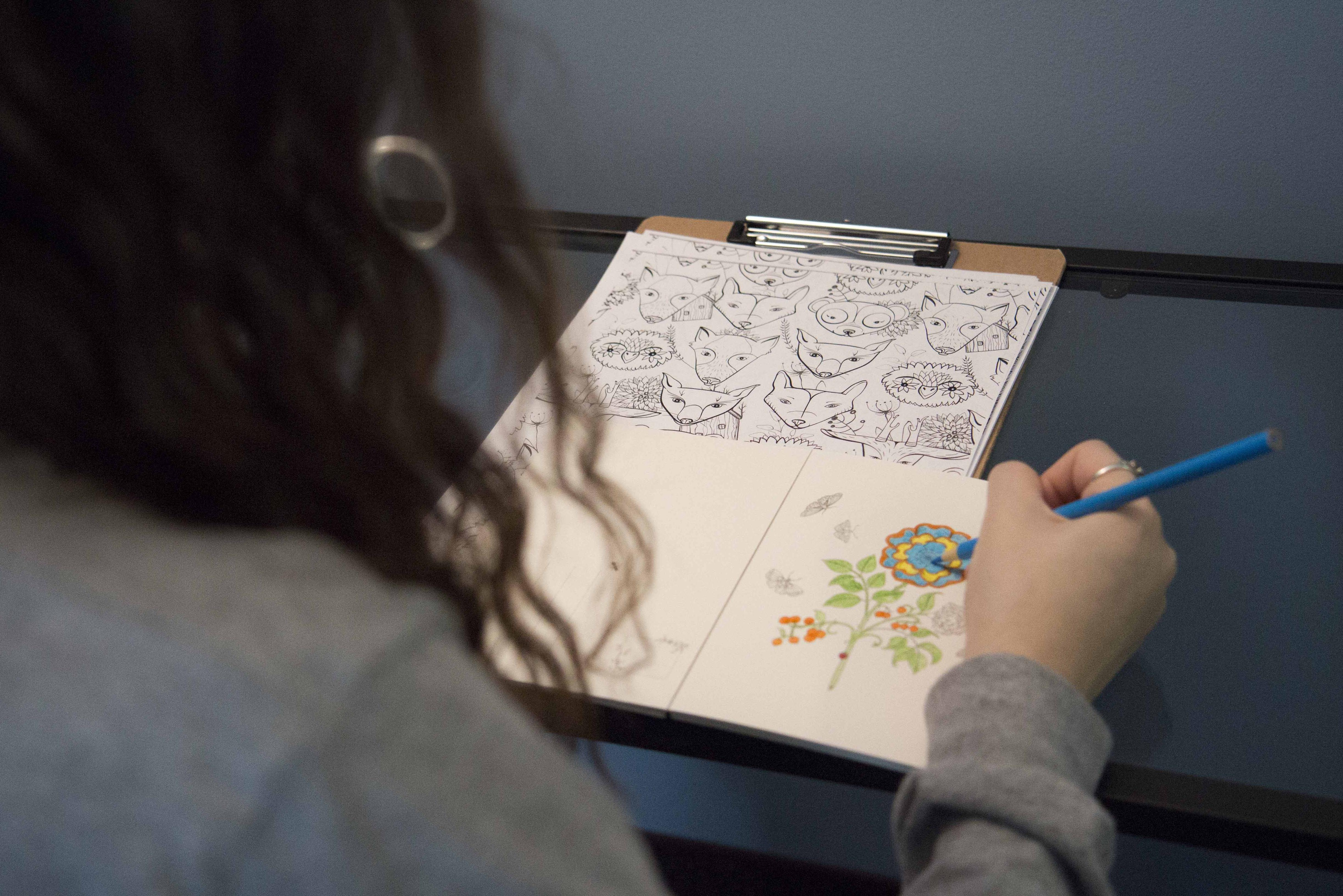 Female student coloring Mandala page in Relaxation Room.