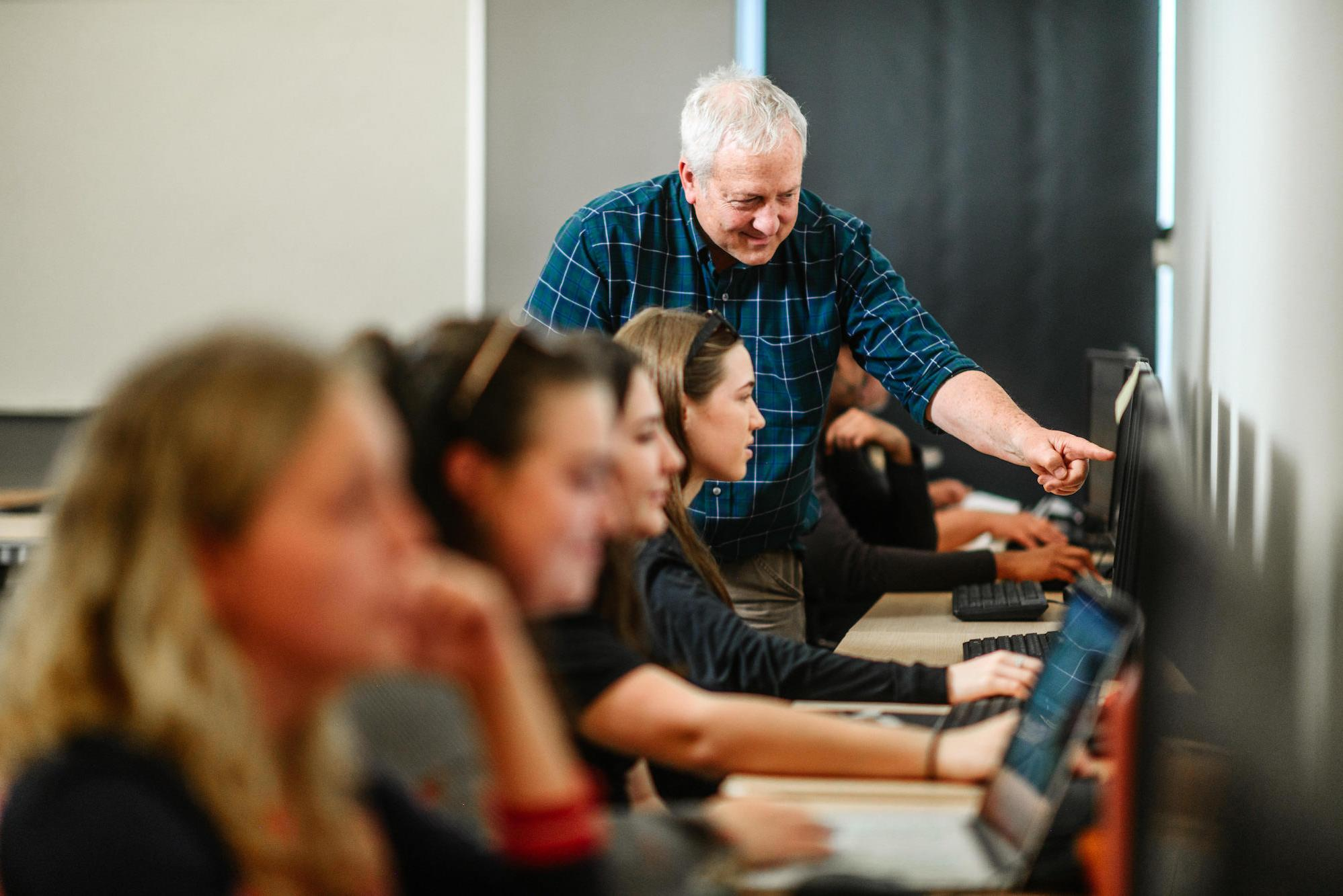 Professor of Media and Communication Alan Powell teaching class.