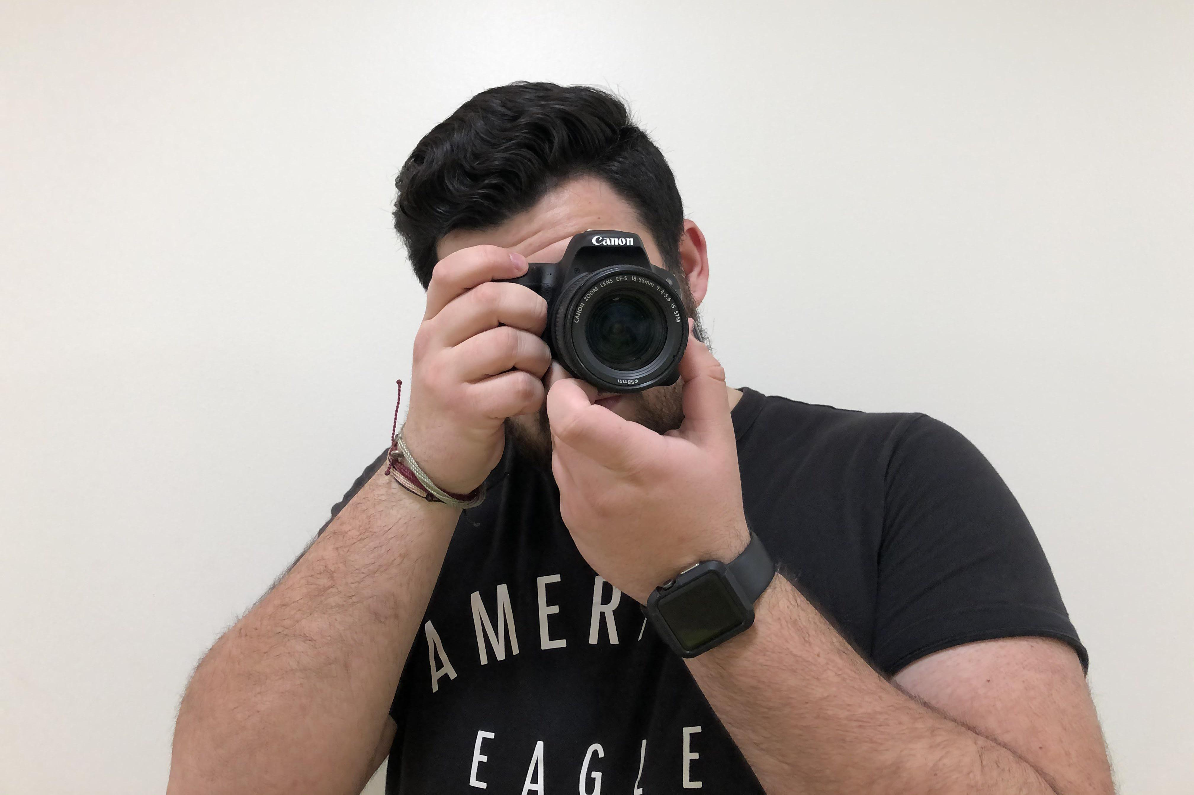 Anthony Carbonetta holding a camera to shoot a short film