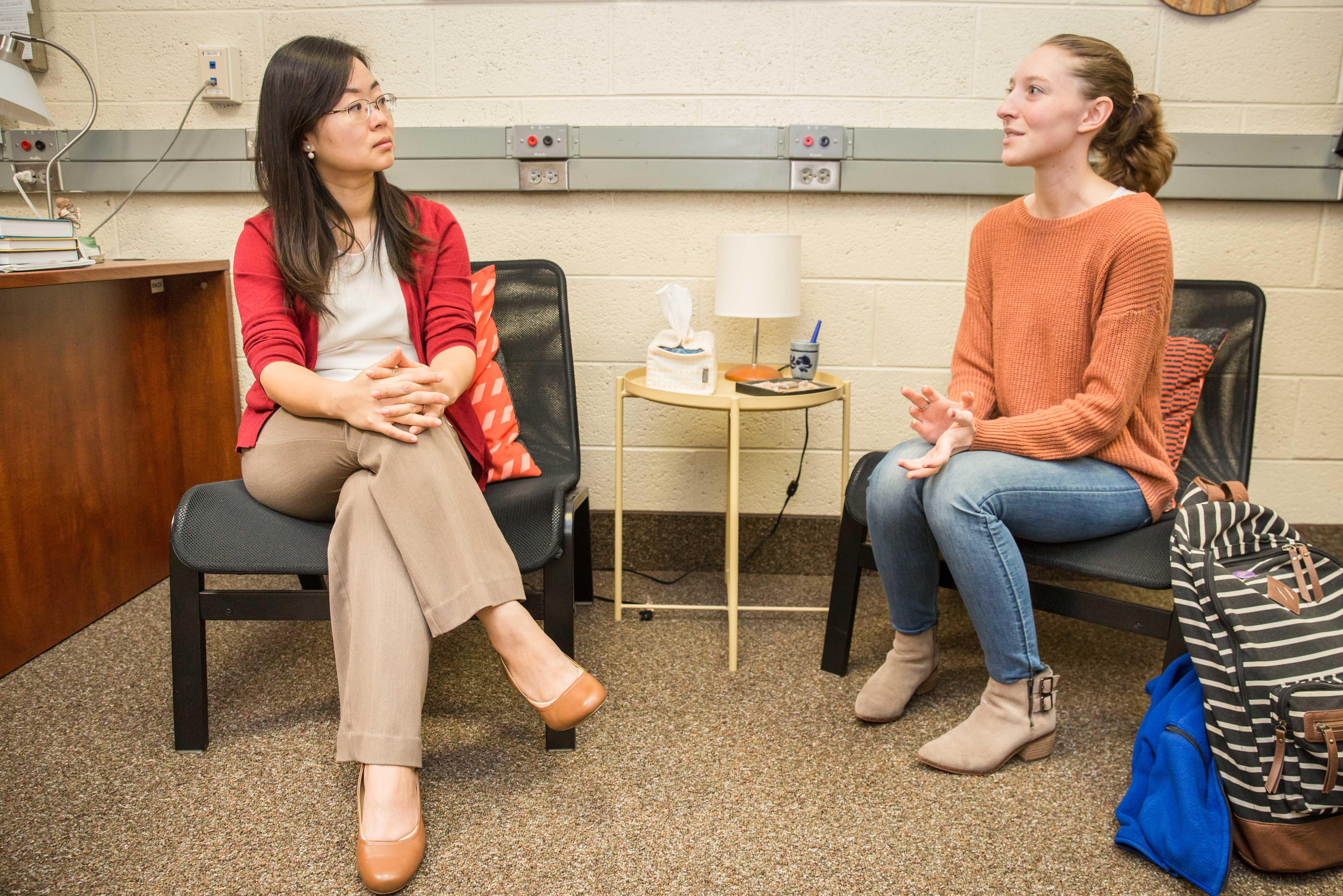 Dr. Hsin-Hua Cathy Lee talking to Arcadia student