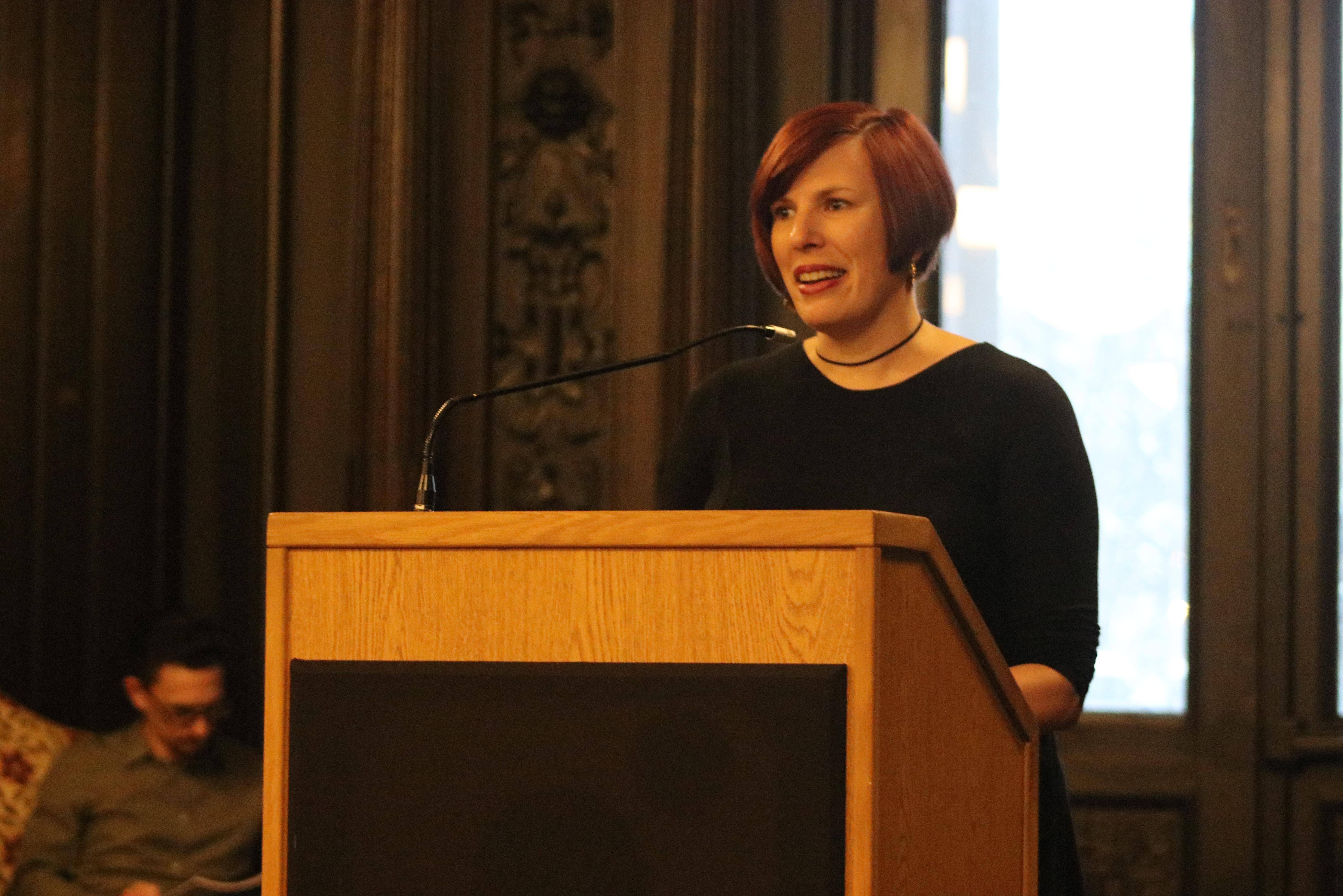 Assistant Professor Tracey Levine reading at a faculty creative writing lecture.