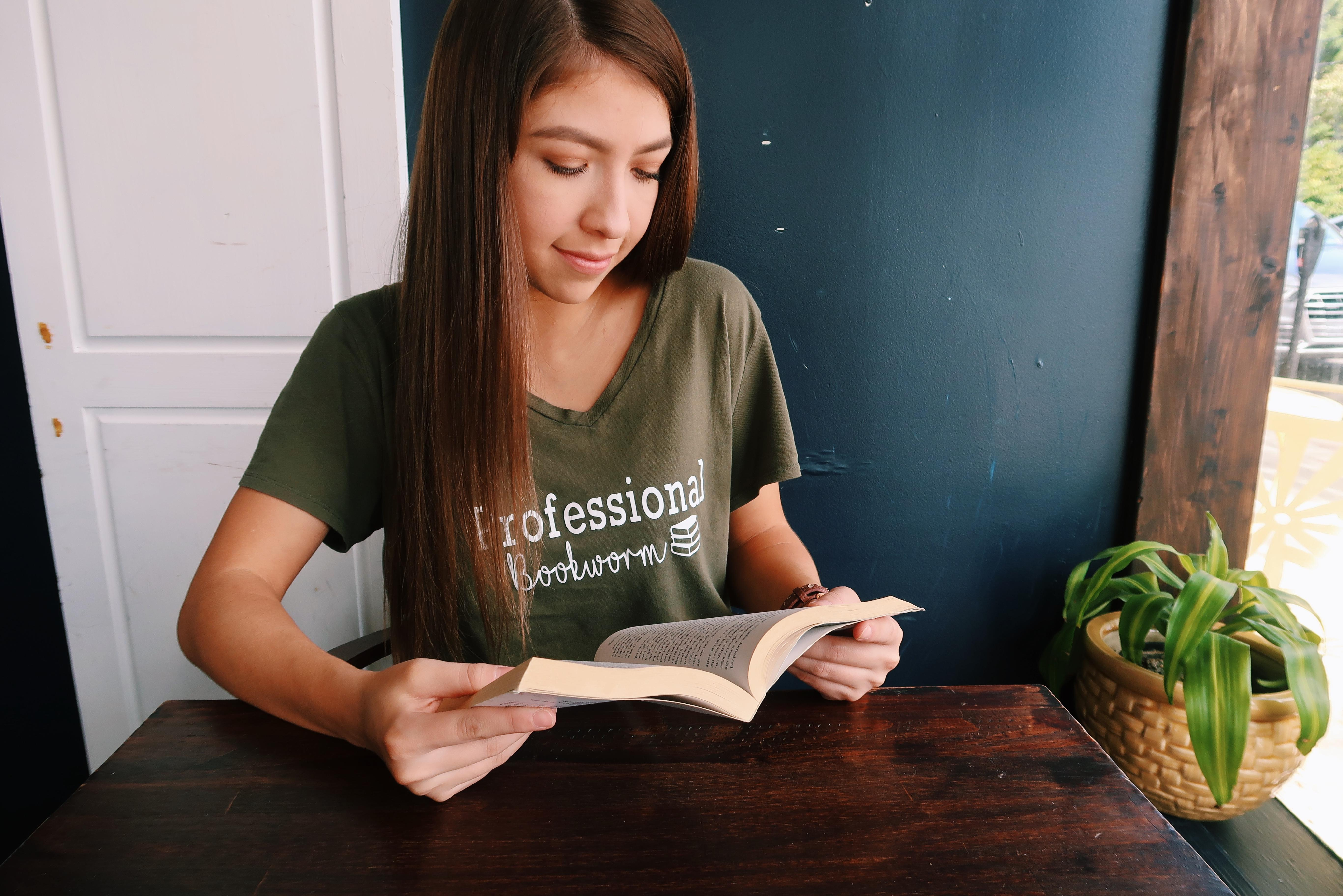 Jasmin Ramirez reading a book at home