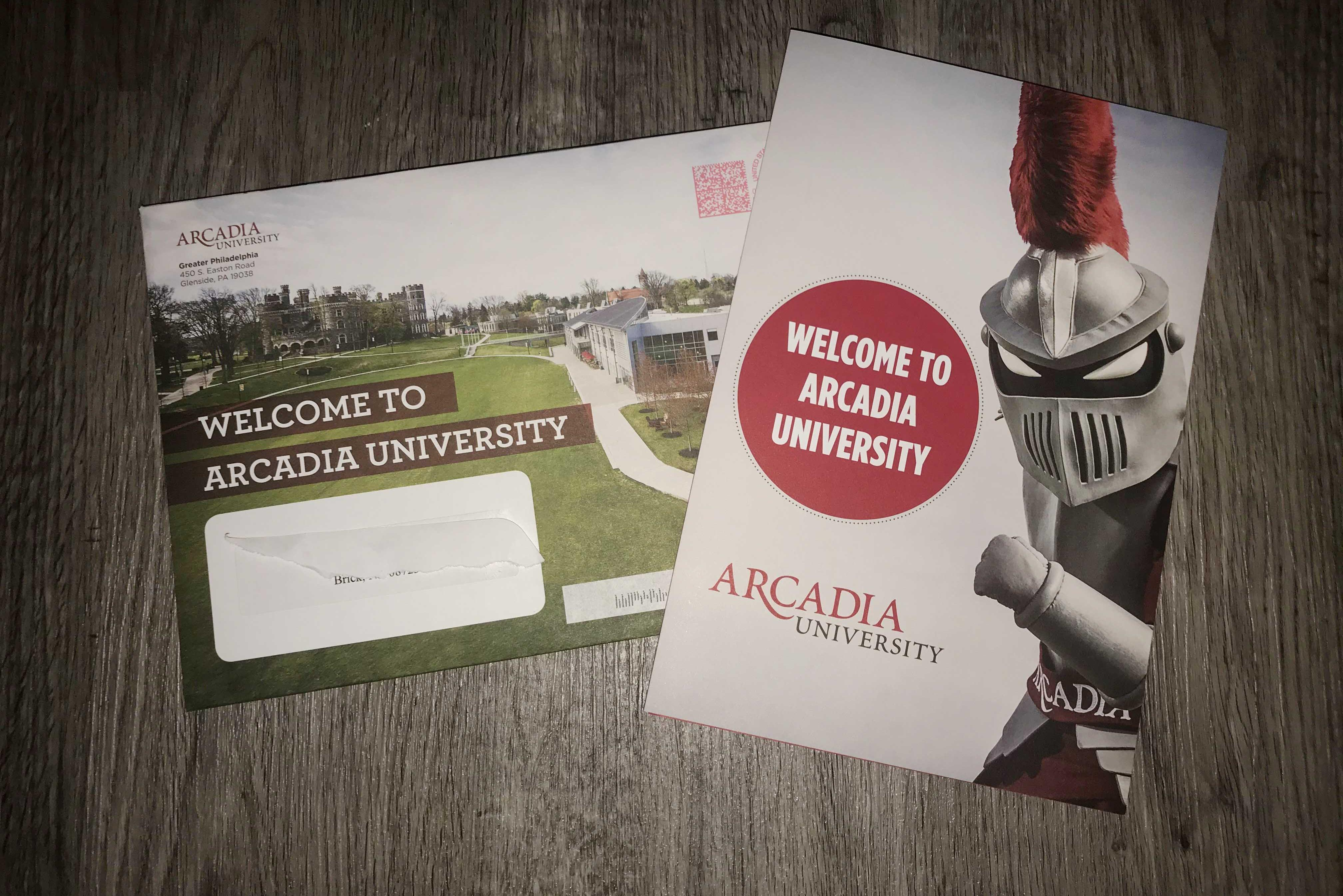 Welcome to Arcadia letter and brochure sitting on a table.