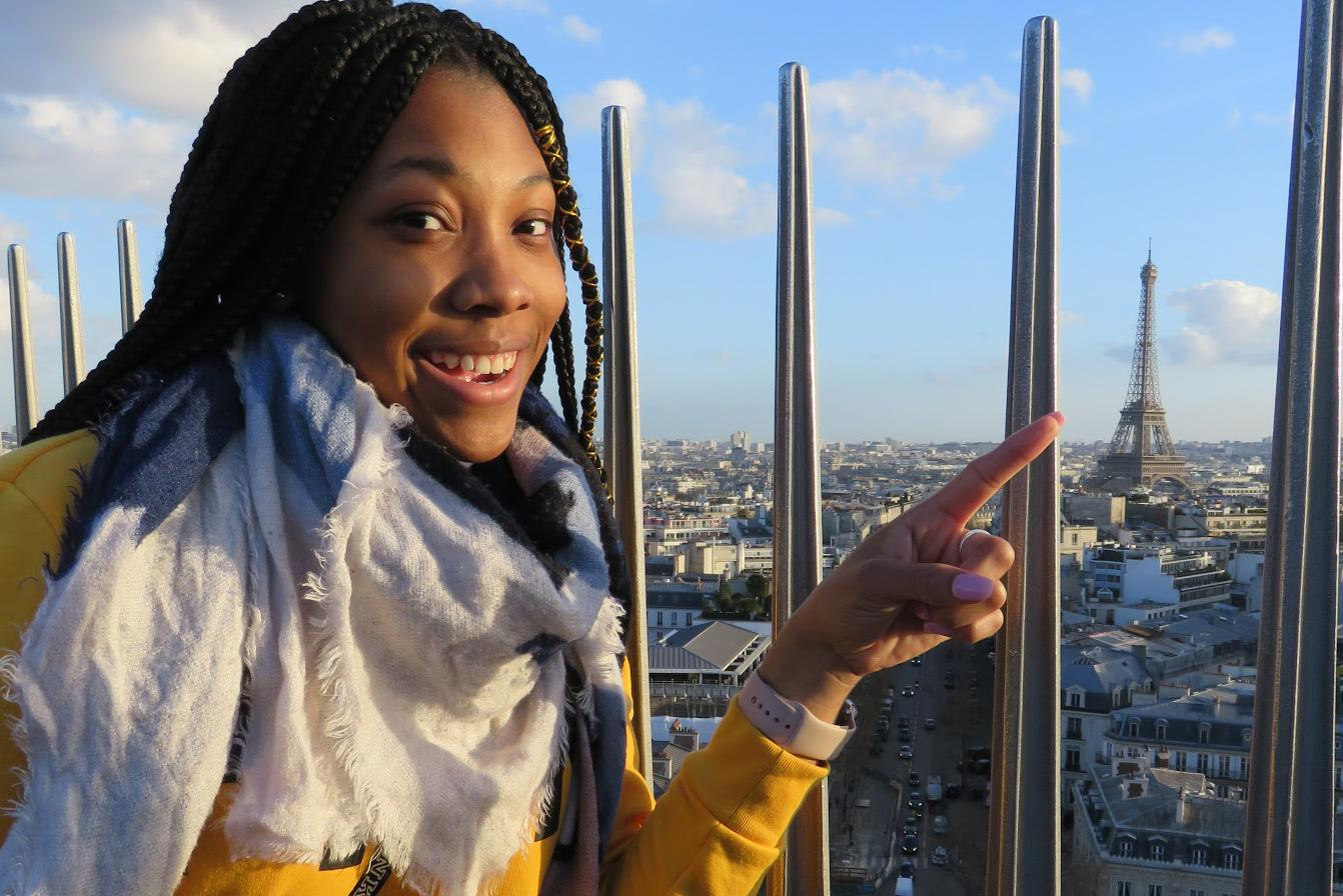 Arcadia University student points at the Eiffel Tower from Arc de Triumph
