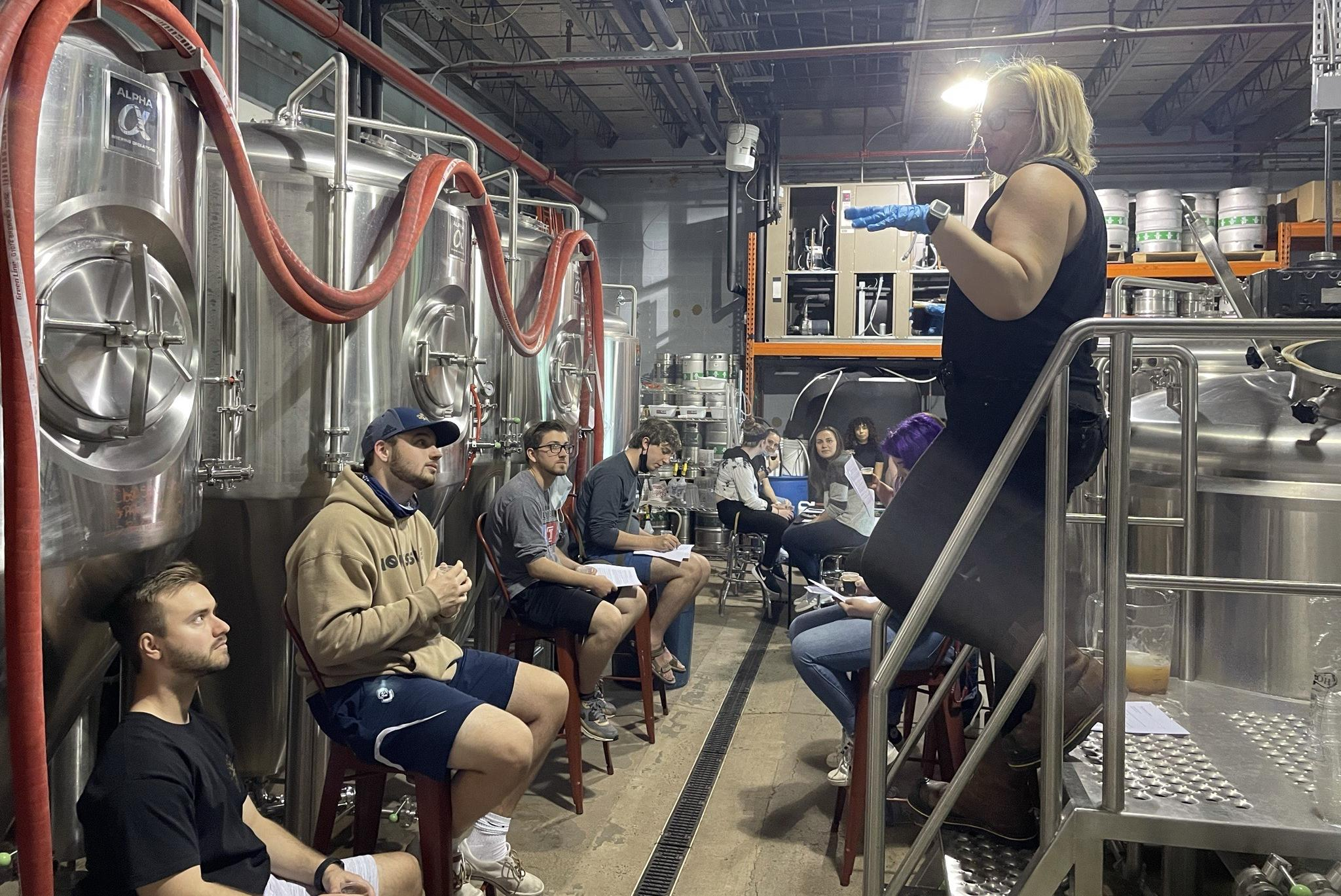 Female brewer at Naked Brewing meets with 8+ Arcadia University students