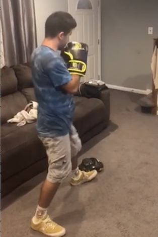 Anthony working out in his house