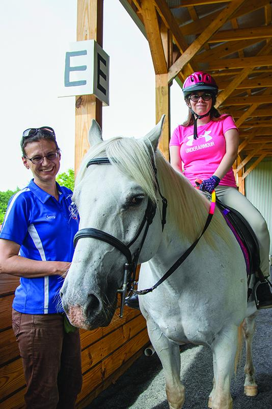 SRA member trains with a therapeutic riding instructor.