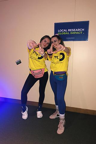 Two female students pose for a photo during Thon in the commons.