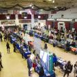 Alumni Gymnasium during career fair filled with students and employers.