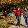 Students walking on campus with masks on