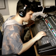 Student Anthony Carbonetta using a soundboard while filming his short film