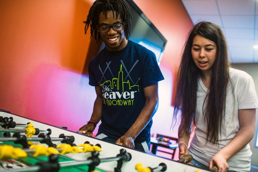 Students playing foosball in the Commons Game Room