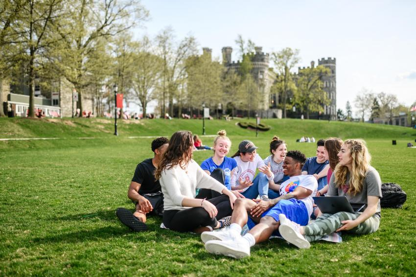 Students sitting on Haber Green field