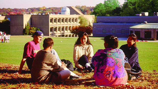Students from 1994 hanging on out campus.