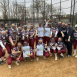 Arcadia University softball team shows their Gift of Life bracelets on the field