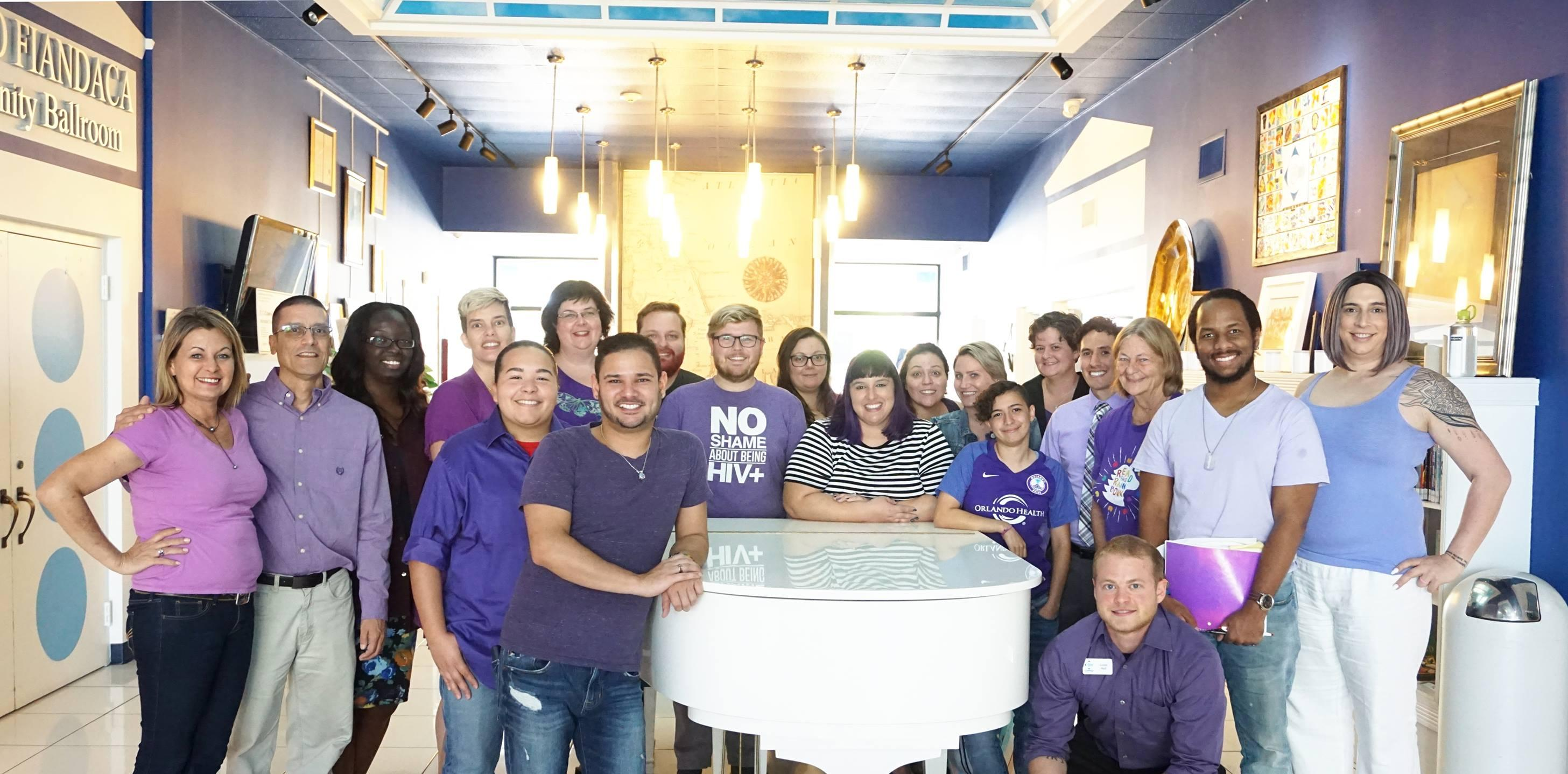 Gonzalez with the Compass staff, all in lavender for anti-bullying campaign.