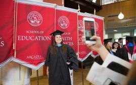 School of Education student getting picture taken during graduation