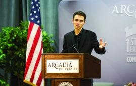 David Hogg speaking at podium at Arcadia University