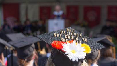 """Graduation cap decorated to say """"She believed she could, so she did"""""""
