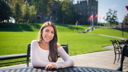 Jasmin Ramirez sitting in front of Grey Towers Castle