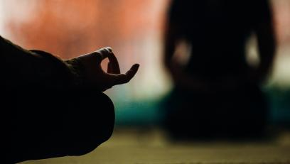 Close up of hands in a meditation pose