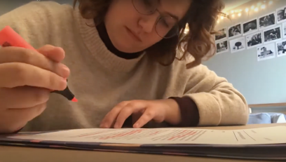 Rikki Rosenthal at her workspace completing an assignment