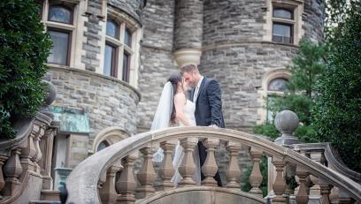 Wedding photography of couple in front of arcadia's grey towers castle