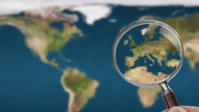 Map of the world under magnifying glass