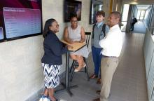 MBA students chatting in Brubaker Hall