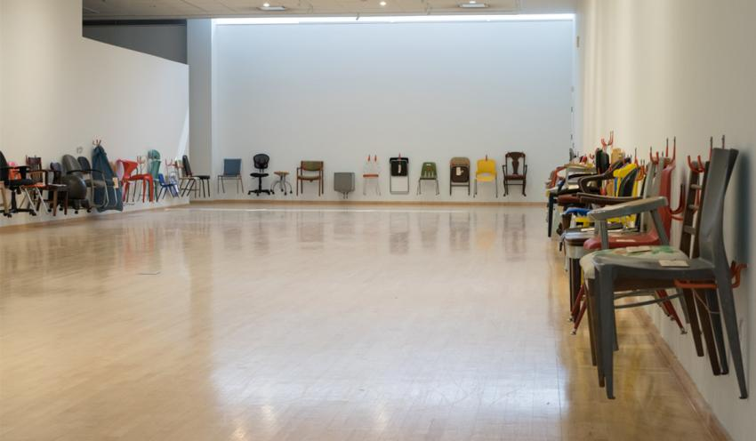 """Arcadia's chair, third from the left on the rear wall, was originally purchased for 2001's """"Printed Matter"""" exhibit."""