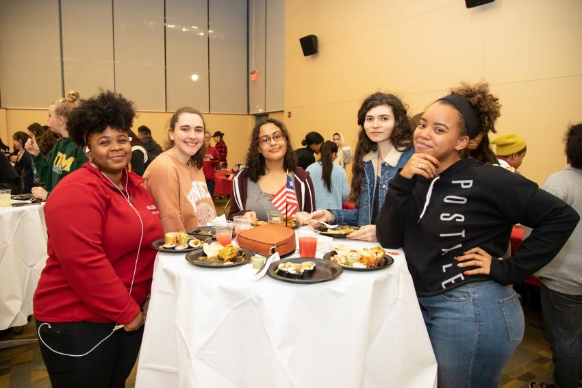 Group of five students at the Celebrating Cultures event