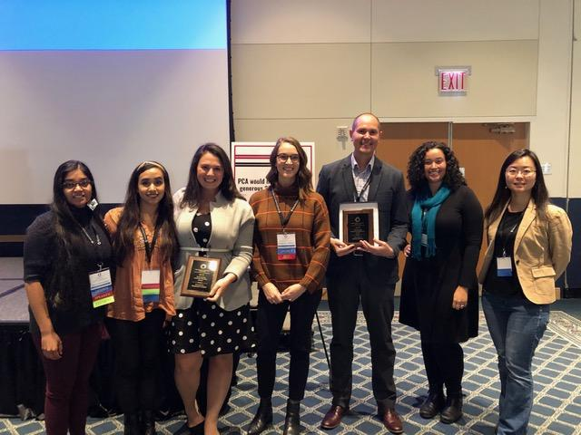 Students and faculty at the conference with awards