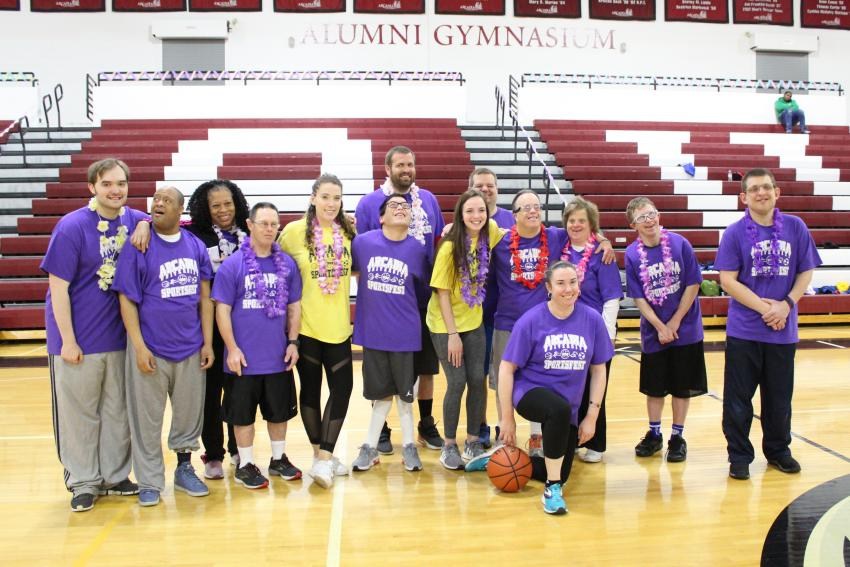 Student volunteers with members of the purple team at Sportsfest