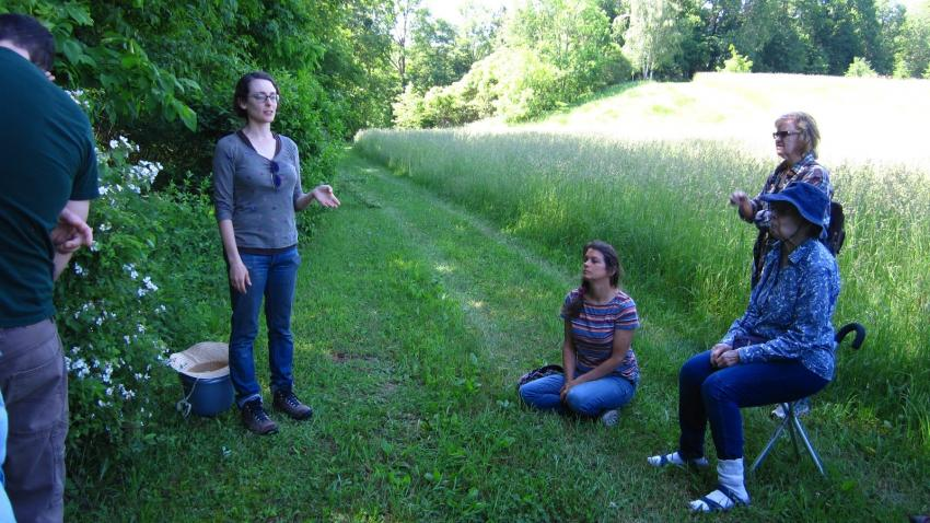 Woman gives tour of nature preserve