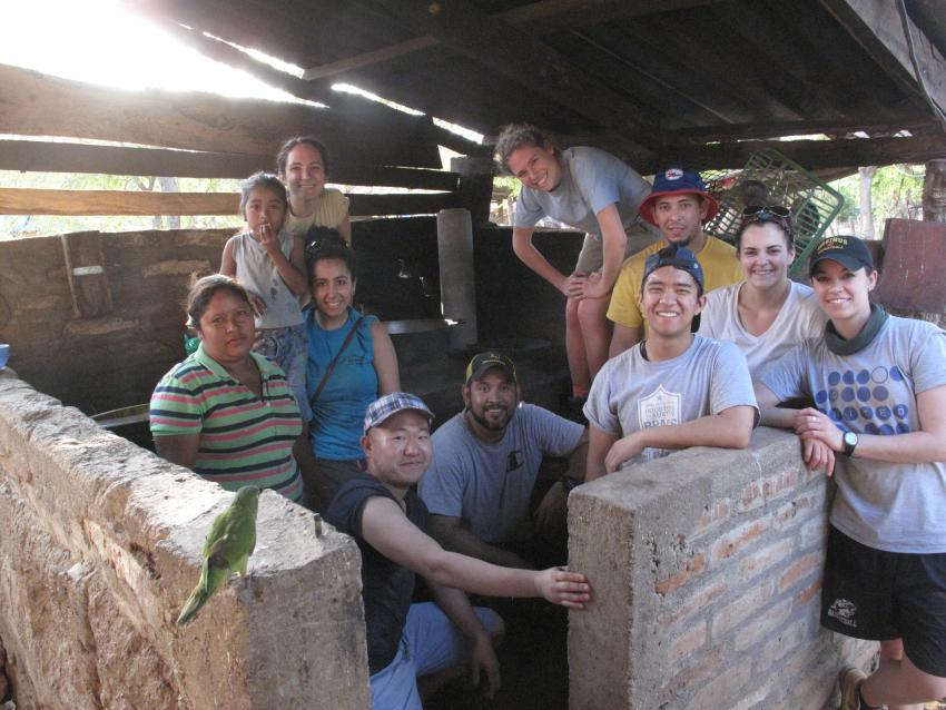 Public Health students work with families in Nicaragua to build mud stoves.