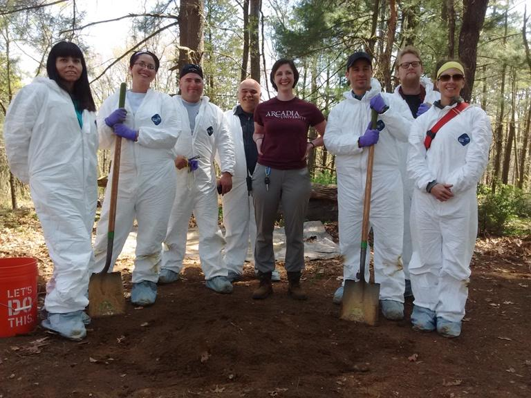 Assistant Director of Forensic Science Kimberlee Moran with participants of a forensic archaeology field course.