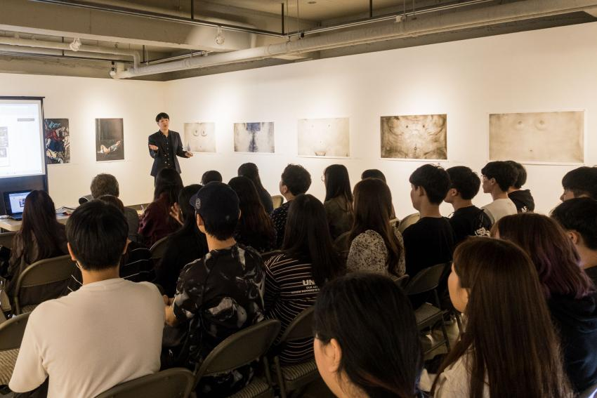 June Yong Lee presenting at photo festival in South Korea.