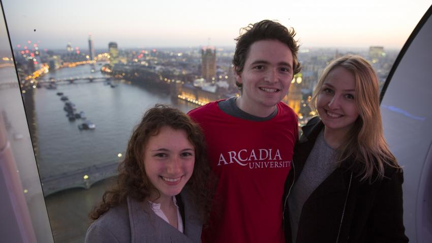Three Arcadia students with London in background