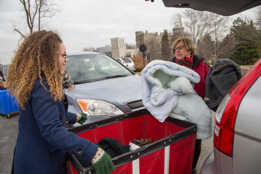 Claire McEntire '18 assists Flourtown resident Kate Boczar with donations at the Repurposing, eWaste, and Shredding event.