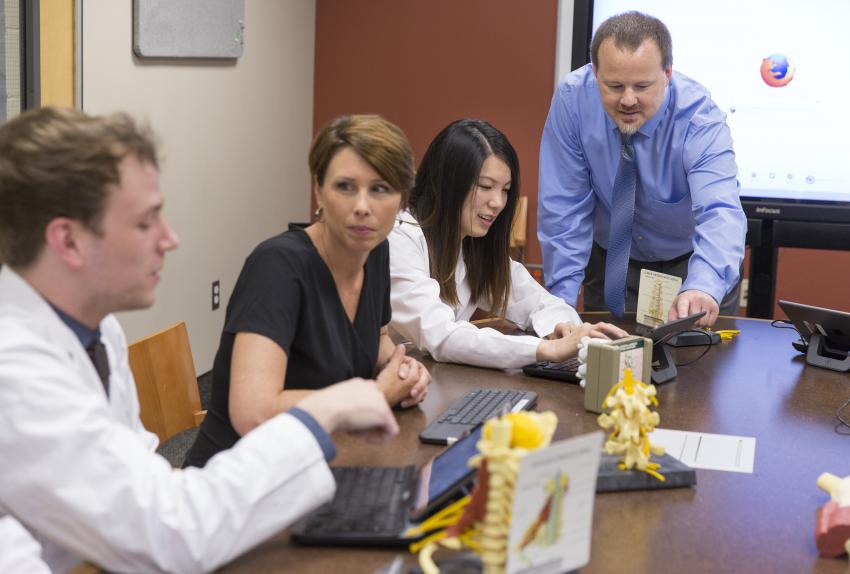 Students and faculty in Physician Assistant work together