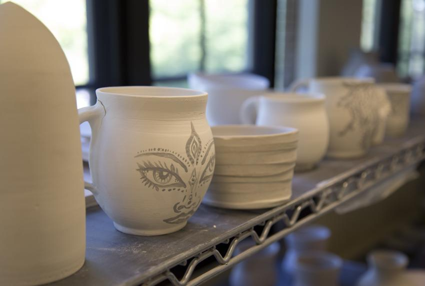 Clay is turned into ceramic in an electric kiln before being glazed and finished.