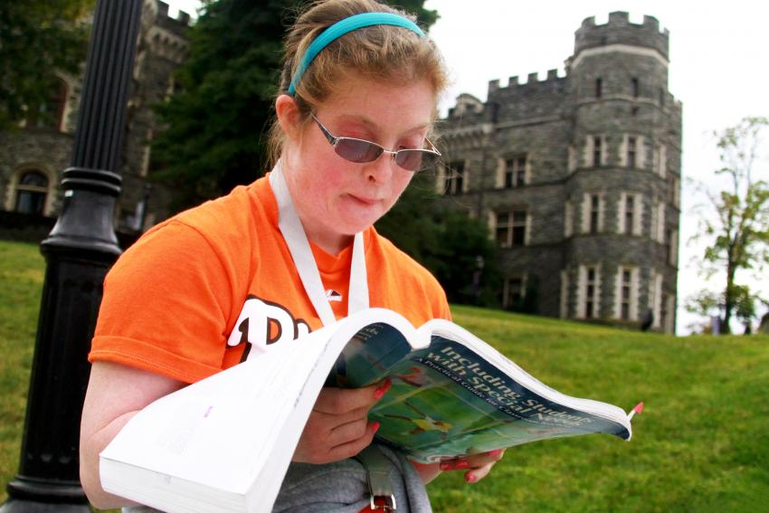 Megan Murphy '15 studies in front of the castle.