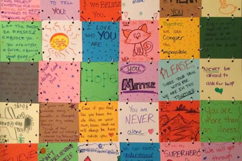 A paper quilt of messages to those with mental illness, part of a project by Lindsay Miller '16 for the Radical Arts Exhibit.