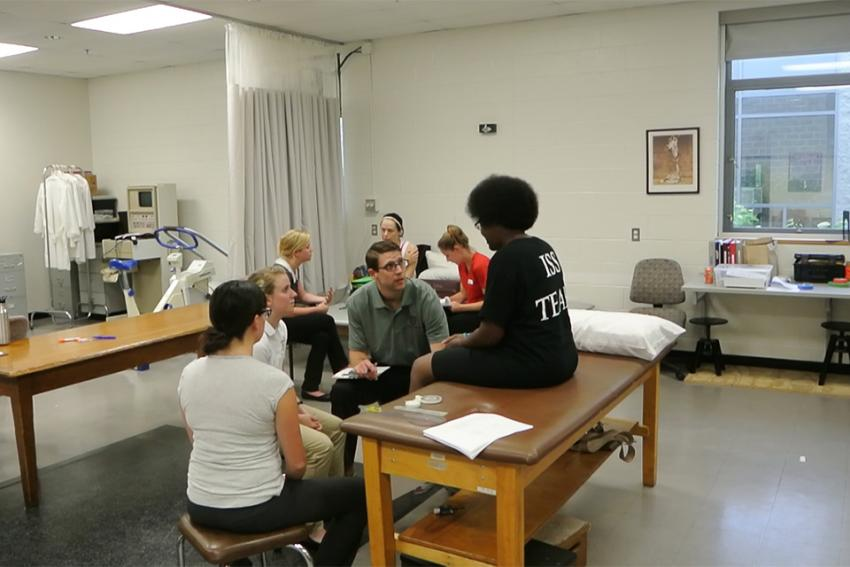 Doctor of Physical Therapy students work with a runner from Back on My Feet at a 2014 clinic.