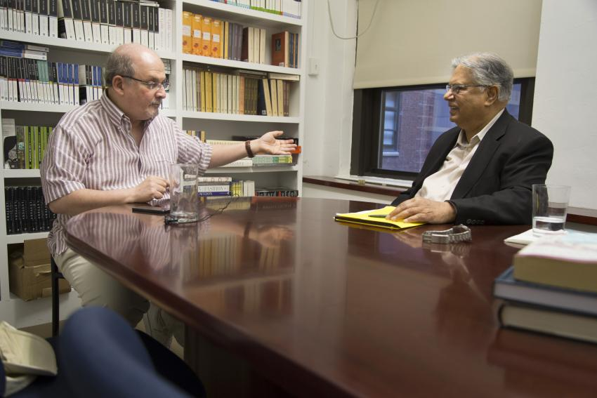 Dr. Chauhan (right) interviews author and literary legend Salman Rushdie (left) in July 2015.