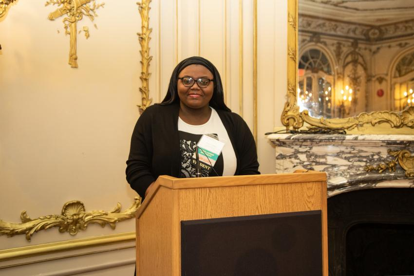 Aliyah Pulley stands at the podium in the Laura Minerva Korman Mirror Room