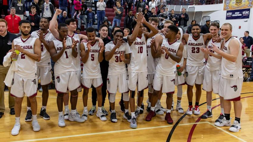Men's basketball team cheers after they win the MAC Commonwealth Championship