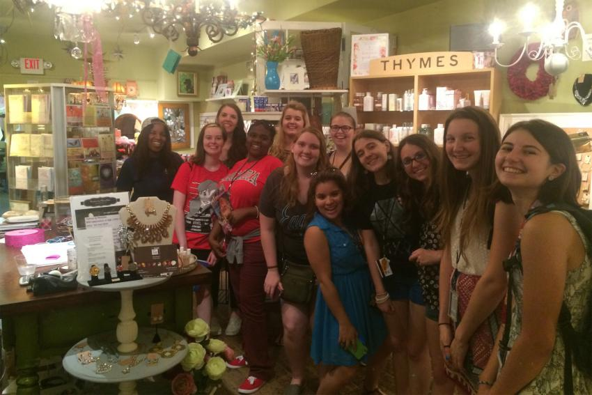 A group of new students visit Sweet Magnolia in downtown Glenside.