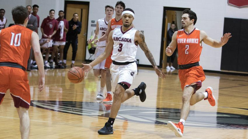 Men's basketball Josh Scott moves the ball down court in the MAC semi finals.